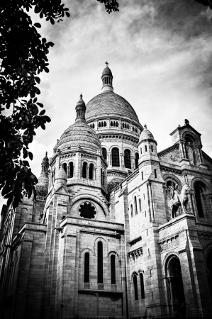 sacred heart: View of Basilica of the Sacred Heart of Paris with cloudy sky in background (Paris, France, Europe).