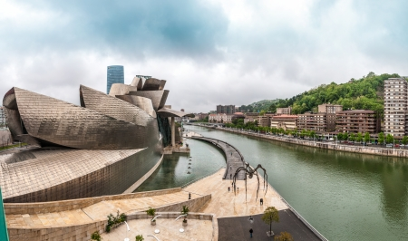 BILBAO, SPAIN - MAY 18: Panorama of Guggenheim Museum Bilbao. It was built at cost of 89 million dollars and featured in James Bond film World Is Not Enough. May 18, 2012, Bilbao, Spain, Europe.