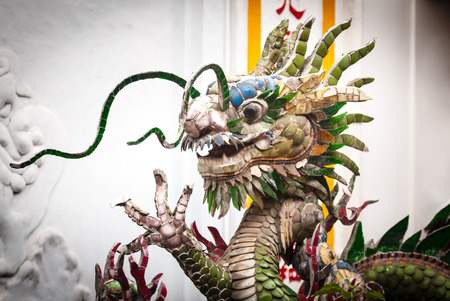 fictional character: Dragon statue in Vietnam, Asia. Famous attraction, popular tourist place. Fictional character. Head with furious face and body of dragon. Traditional eastern culture.