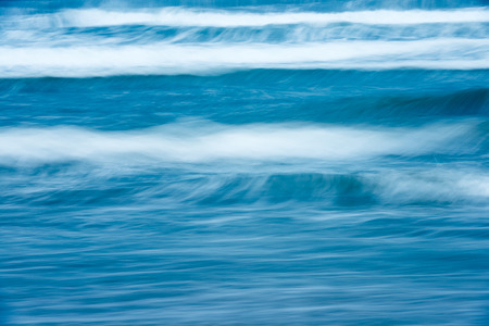 waterscape: Scenic view of bright blue rough ocean with big foamy waves. Picturesque sea. Beautiful stormy waterscape and natural power. Amazing backgrounds and wallpapers.