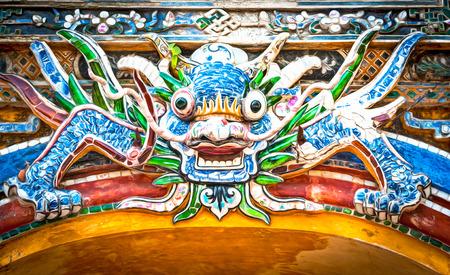 citadel: Dragon over gate to Hue citadel. Vietnam, Asia.