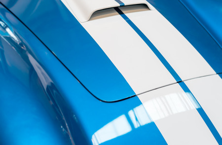 coachwork: Blue and White Striped Hood with Hood Vent of Classic Car Stock Photo