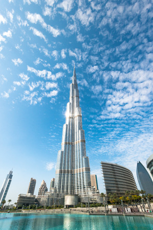 Dubai, UAE - December 8, 2012: Burj Khalifa vanishing in blue sky. It is tallest structure in world since 2010, 829.8 metres.
