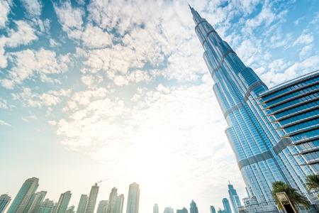 december: Dubai, UAE - December 8, 2012: Burj Khalifa vanishing in blue sky. It is tallest structure in world since 2010, 829.8 metres.