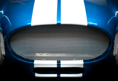 car detail: Detail of Grille of Blue and White Striped Classic Car Stock Photo