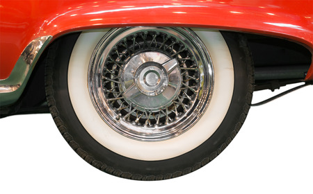 Close Up of Whitewall Tire of Red Classic Car on White Background Stock Photo