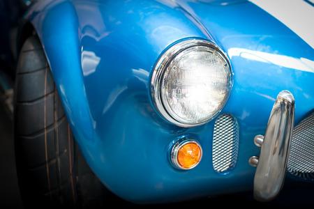 coachwork: Close Up Headlight Detail of Blue Classic car