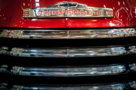 grille: Moscow, Russia - March 3, 2013: Radiator grille and badge of a red classic vintage Chevrolet car, close up detail.