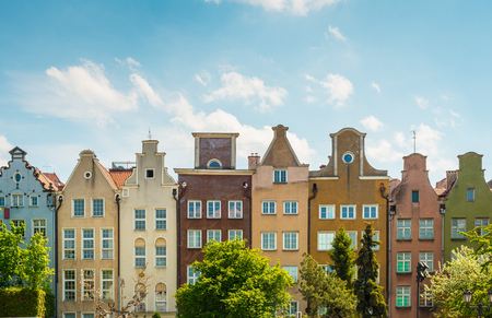 row of houses: Old and narrow houses in street of Gdansk, Poland, Europe. Beautiful sunny day, colorful narrow buildings standing in row.