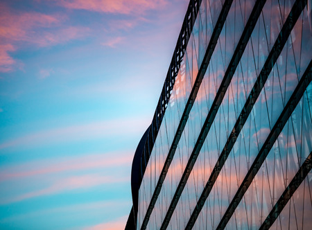 exterior architecture: Sunset reflection in glass panels of modern building in Pest part of Budapest city, Hungary, Europe.