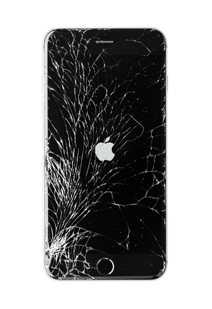 Moscow, Russia - November 22, 2015: Photo of iPhone 6 plus with broken display. Modern smartphone with damaged glass screen isolated on white background. Device needs repair. Editorial