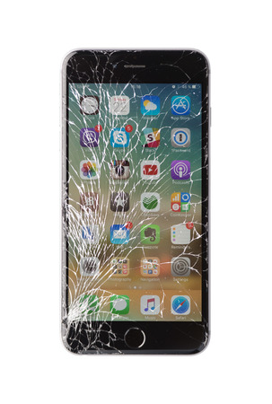 cracks: Moscow, Russia - November 22, 2015: Photo of iPhone 6 plus with broken display. Modern smartphone with damaged glass screen isolated on white background. Device needs repair. Editorial