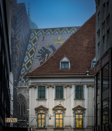old town house: View on old town house and roof of St. Stephen cathedral. Night scene from Vienna, Austria. Europe travel. Stock Photo