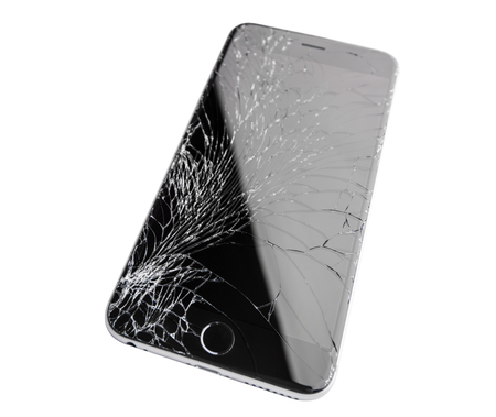 broken telephone: Moscow, Russia - November 22, 2015: Photo of iPhone 6 plus with broken display. Modern smartphone with damaged glass screen isolated on white background. Device needs repair. Editorial