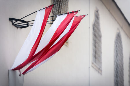 city building: Austrian flag on wall of building in old town Vienna. Europe travel.