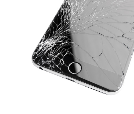 Moscow, Russia - November 22, 2015: Photo of iPhone 6 plus with broken display. Modern smartphone with damaged glass screen isolated on white background. Device needs repair. Redactioneel
