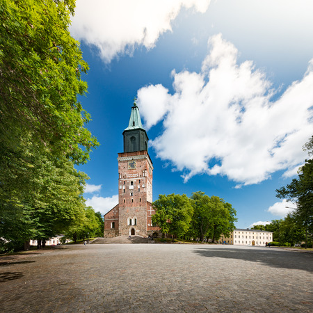 turku: Turku Cathedral on sunny day with blue cloudy sky in background and empty square in foreground