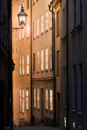 stan: Sunrise or sunset in street of Gamla stan. Stockholm, Sweden, Scandinavia, Europe.