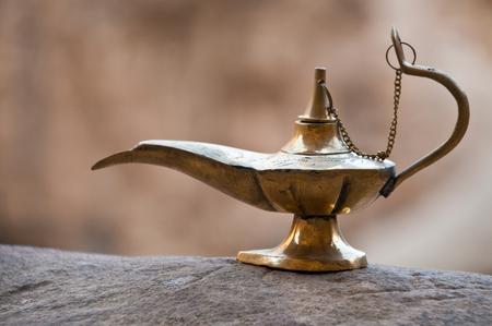 old arabian, aladdin style, lamp on the rocky ground of Jordan