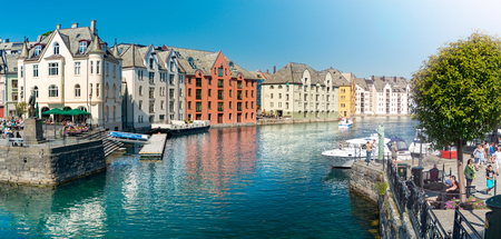 Alesund, Norway - 26 July, 2013: view of central city part with historic art nouveau architectural style in which most of the town was rebuilt after a fire in 1904. Popular tourist destination in Scandinavia, Europe.