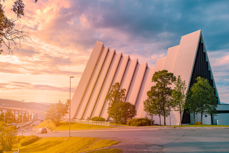 Arctic cathedral in Tromso, Norway, Scandinavia, Europe. Cloudy sunset sky in background. Architecture and religion.