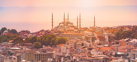 Panorama of Istanbul skyline with imperial mosque at sunset. Sun, sky and mountains in background and city in foreground Reklamní fotografie