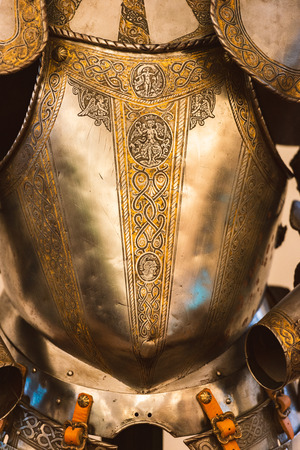 Vintage golden full plate armor suite with intricate ornament