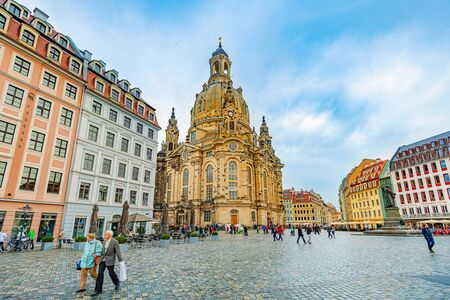 DRESDEN, GERMANY - SEPTEMBER 22, 2014: Frauenkirche cathedral in Dresden, Germany. Church of Our Lady is a Lutheran church in state of Saxony. View from square with people walking around Editorial