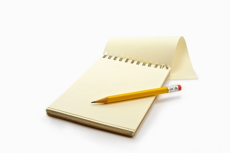Notepad and pencil on the white background