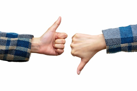 Thumb up and thumb down hand signs isolated on white Stock Photo - 12861335