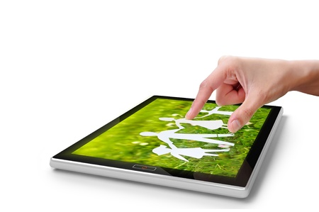 Hand touching screen on digital tablet pc  Close-up finger  Stock Photo