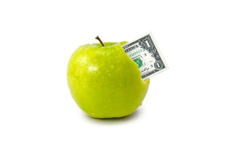 D�lar saliendo de manzana verde aislado sobre fondo blanco Foto de archivo - 13100630