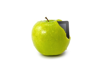 Tablet PC coming out from green apple isolate on white background