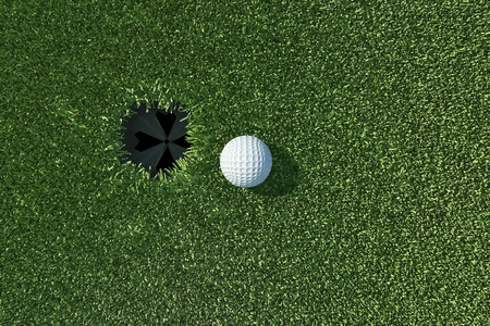 Golf ball go to the hole on lip of cup on green grass photo