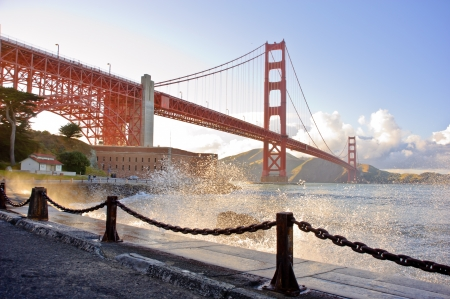 golden: Golden Gate Bridge with water splashing