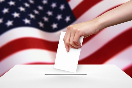 voter: Hand with ballot and box on Flag of USA