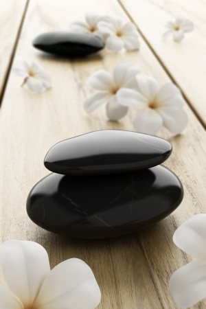 frangipani flower and black stone, zen spa on wood photo