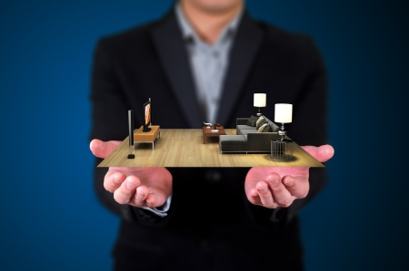 house livingroom in human hands, Businessman Stock Photo