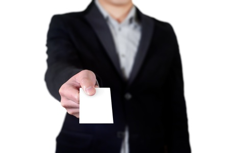 Business man handing a blank business card over white background Stock Photo - 13646325
