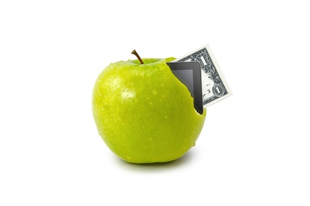 Tablet and dollar coming out from green apple isolate on white background Stock Photo - 13646326