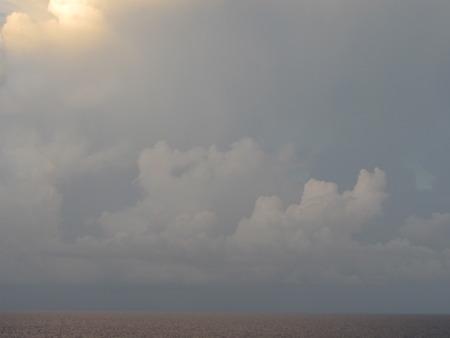 Sun and Clouds Over the Atlantic Фото со стока
