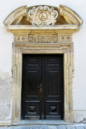 An old entrance to a public catholic school in lower austria