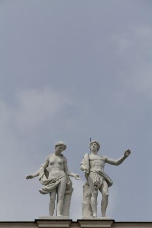 Two statues on castle Belvedere in Vienna, Austria photo