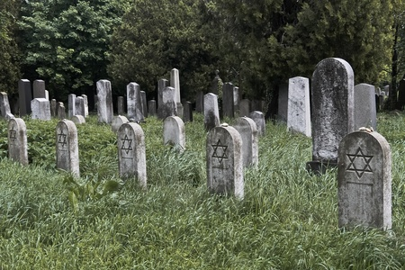 A set of jewish nameless graves with stones on the tombstones as the sign for having been visited recently Stock Photo - 9550310