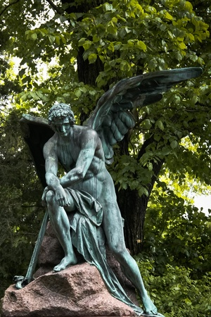 Lonely angel protecting a grave on Viennas central cemetery photo