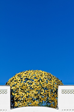 A golden cupola consisting of metal laurels on a museum in Vienna photo