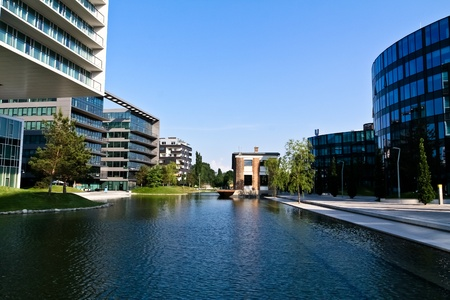 A modern district in Vienna next to an artificial lake photo