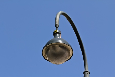 An isolated street lamp in the streets of Vienna photo