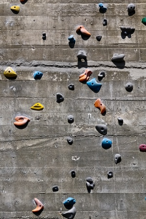 green wall: A segment of a climbing wall with a difficult pattern Stock Photo