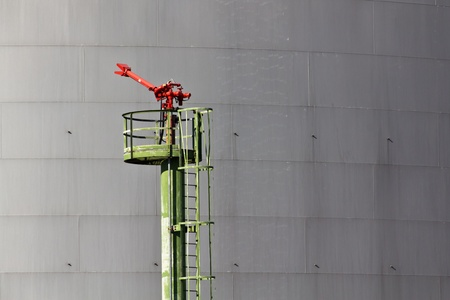 A fire extinguisher on an industrial area where oil and gas is stored photo